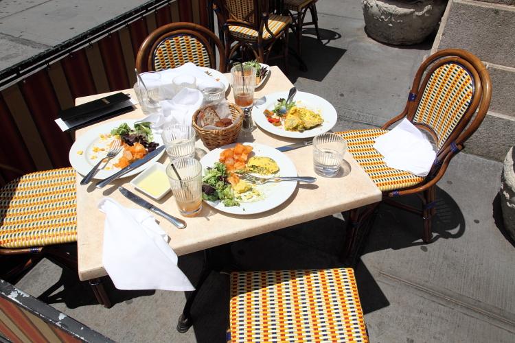 Half-eaten brunch  sidewalk table  Upper West Side  Manhattan