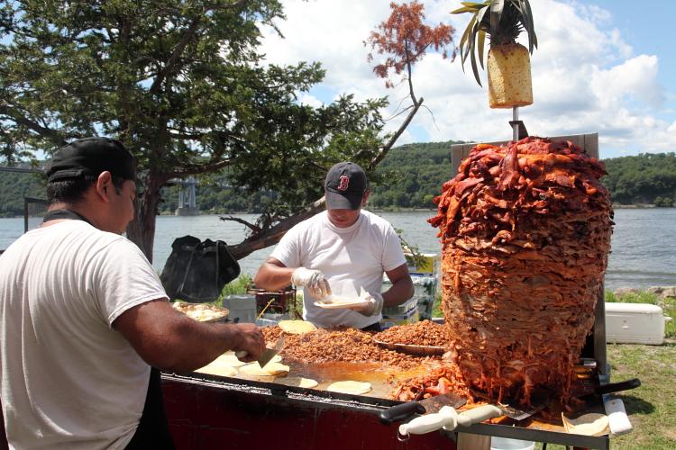 Preparing tacos al pastor  La Guelaguetza  Victor C Waryas Park  Poughkeepsie  New York