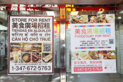 Stalls for rent in a future Elmhurst food court  advertised in English  Chinese  Spanish  Hindi  and Vietnamese  posted in Flushing  Queens