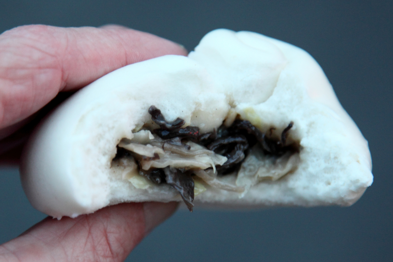 Cabbage-and-wood-ear steamed bun (biteaway view)  Gaoming Bakery  Sunset Park  Brooklyn