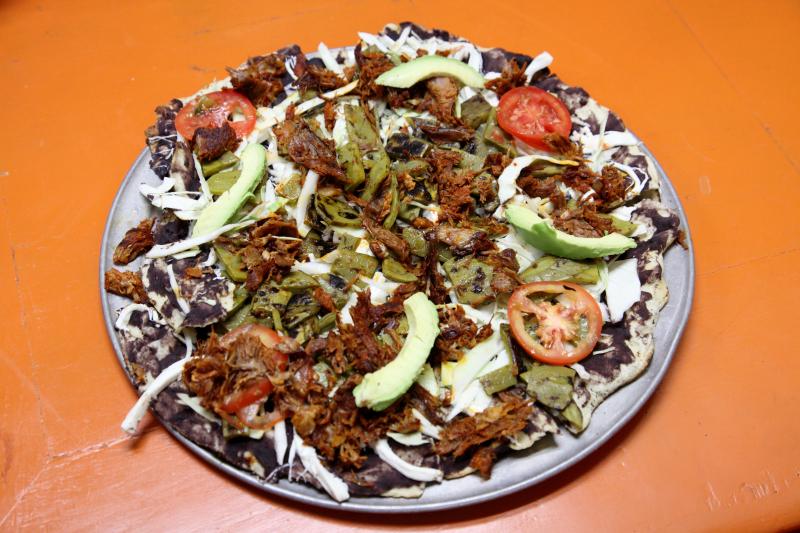 Tlayuda with barbacoa de chivo and nopales  La Cienega  Corona  Queens