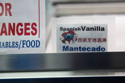 Label in English  Chinese  and Spanish  Helado de Coco at LuvUms Tropical Ices  Sunset Park  Brooklyn
