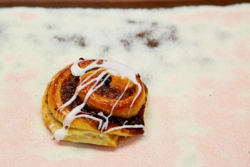 Cinnamon raisin danish on the countertop of Sal & Dom's Pastry Shop  Laconia  Bronx