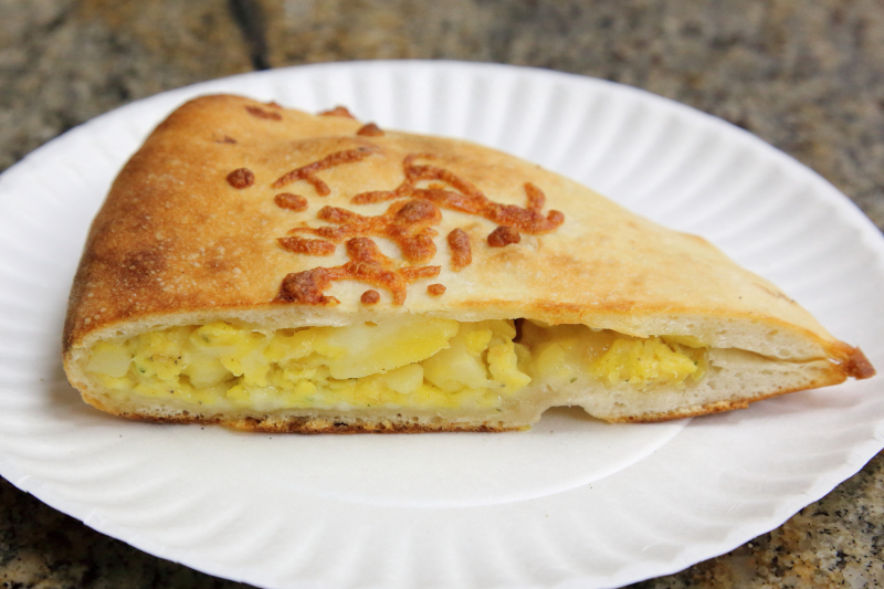 Potato-and-egg calzone (slice)  Crosby Pizza Stop  Pelham Bay  Bronx
