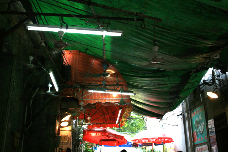Fans  lights  and wiring  outdoor noodle eatery  Guangzhou