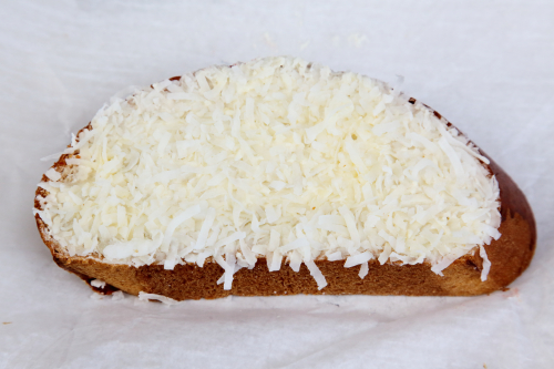 Lemony coconut-topped bread slice (unwrapped)  Grocery Bakery San Agustin  East 116th St  Manhattan