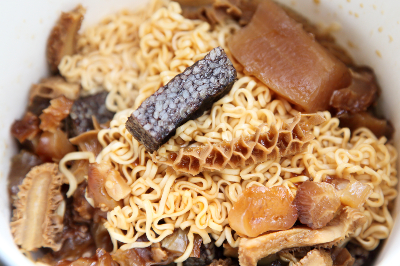 Prince noodles with beef tendon and stomach  daikon  and black rice cake  The Braised Shop  East 10th St  Manhattan