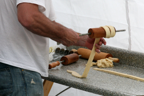 Winding dough for kurtos kalacs  Romania Day Festival  Broadway  New York