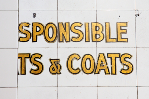 [Not re]sponsible [for ha]ts & coats  most likely  recently exposed surviving signage  Chama Mama  West 14th St  Manhattan
