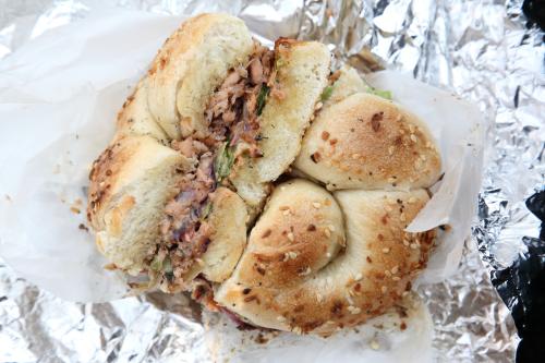 Crunchy fried lox sandwich on braided garlic-sesame bagel  Williamsburg Bagel  Williamsburg  Brooklyn