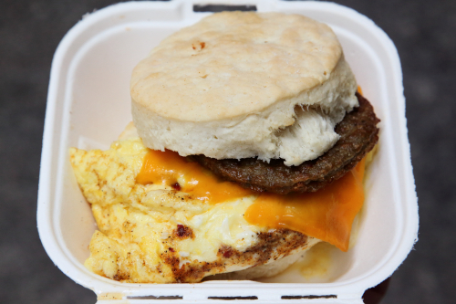 Egg  cheddar  and housemade sausage on a biscuit  Biscuit N' Brisket  East 44th St  Manhattan