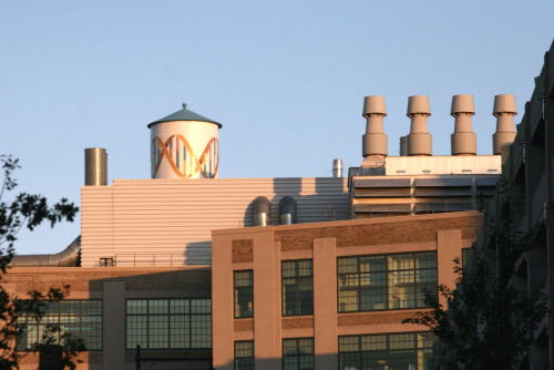 The Novartis water tower  previously painted in Necco colors  Cambridge