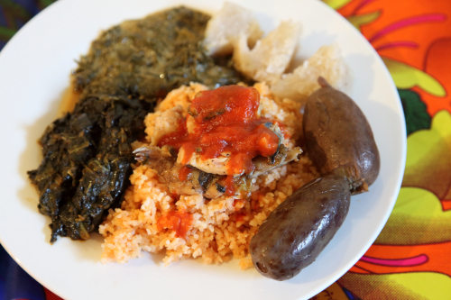 Congolese sampler (catfish over rice  plus spinach  fumbwa  chikwangue  and safou)  Bantu Food Pop-Up  Maysles Documentary Center  Malcolm X Blvd  Manhattan