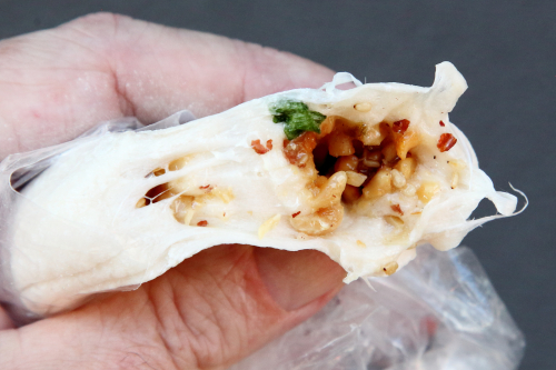 Savory  peanut-filled Chinese taffy (biteaway view)  Flushing  Queens