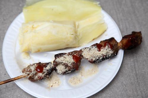Espetinho de porco and pamonha  pork skewer and sweet corn cake  Brazilian Day  West 46th St  Manhattan