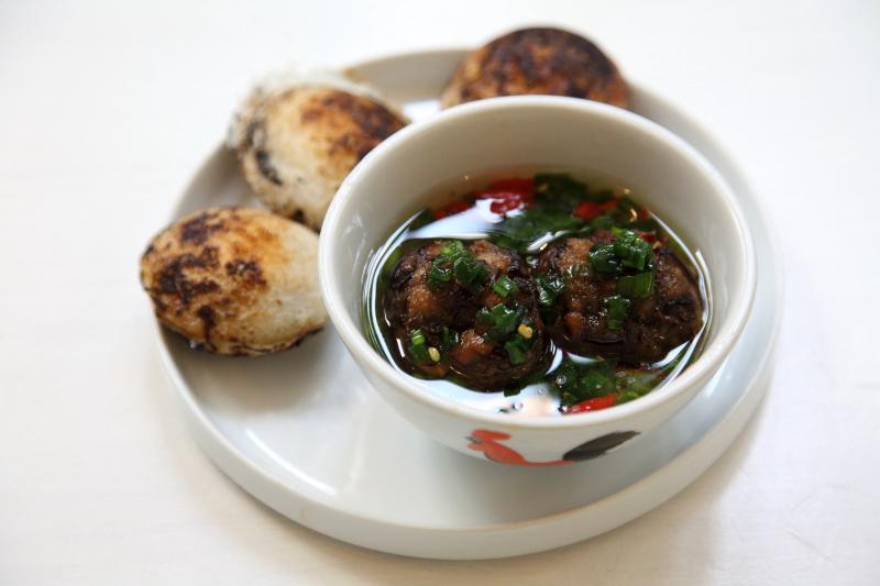 Bánh căn chay  grilled rice muffins with quail egg  and mushroom-taro balls in nước mắm  Di An Di  Greenpoint  Brooklyn