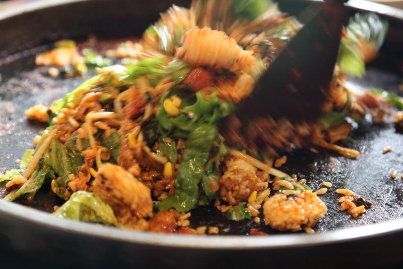 Preparing spicy stir-fried-chicken rice  Doraon 1 point 5 Dak Galbi  Murray Hill  Queens