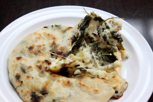 Chipilin-and-cheese pupusa (tearaway view)  Pupusa Zone  Woodside  Queens