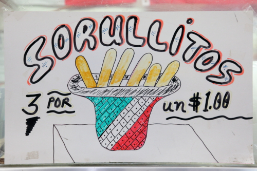 Sorullitos  hand-drawn sign with Puerto Rican snack inside Mexican tricolor basket  American Coffee Shop  Moore Street Market  East Williarmsburg  Brooklyn