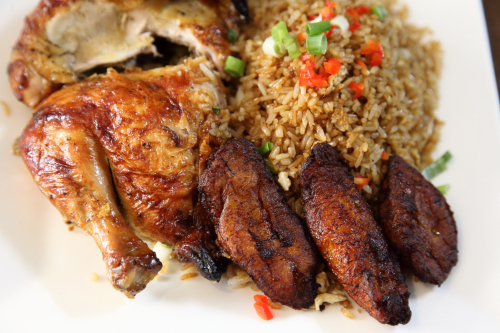 Pollo a la brasa (rotisserie chicken) with fried rice and sweet plantains  Warique  Jackson Heights  Queens