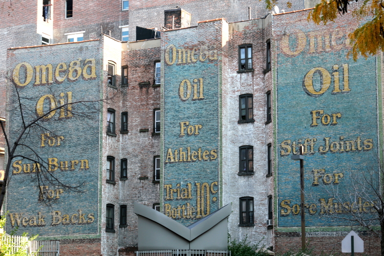 Omega Oil  surviving signage  seen from West 147th St  Manhattan