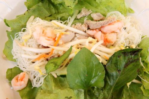 Makings of a lettuce-leaf wrap  Khmer New Year celebration  Wat Jotanaram  Bedford Park  Bronx