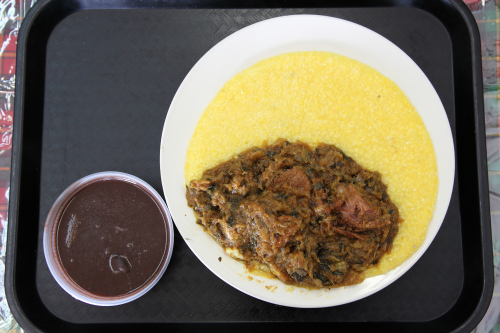 Legim (légumes)  mayi moulen  and sòs pwa nwa  Haitian braised vegetables  cornmeal porridge  and black bean sauce  Elyon Restaurant  Queens Village  Queens
