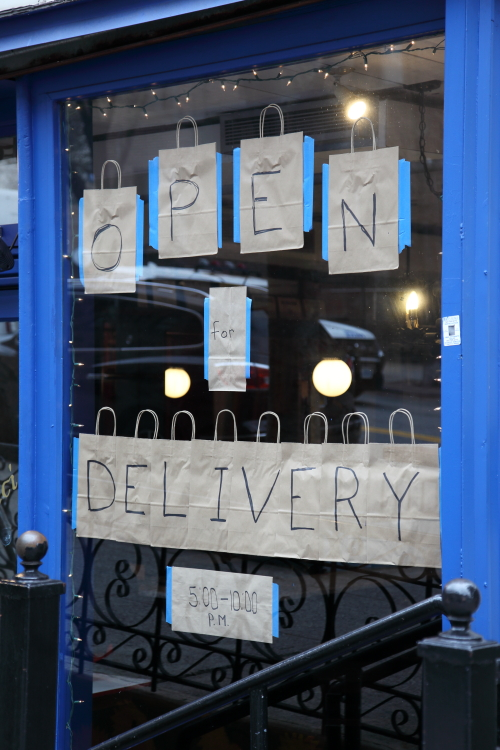 Open for delivery  handwritten signage on delivery bags  Pisticci  La Salle St  Manhattan
