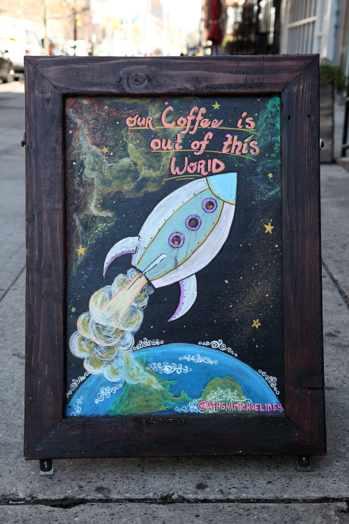 Our coffee is out of this world  hand-drawn signboard (Athena Michaelides  2020)  Double Dutch Espresso  Frederick Douglass Blvd  Manhattan