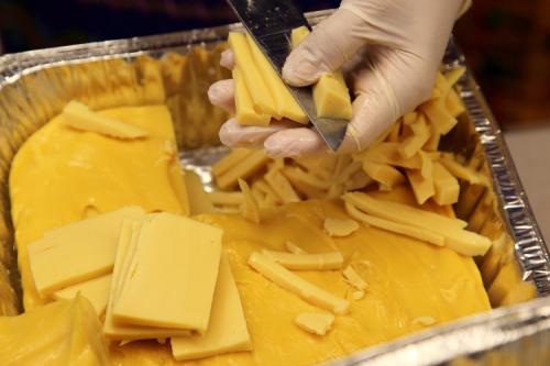 Slicing yellow tofu for tofu thoke  LDBA Thingyan festival  Elmhurst  Queens