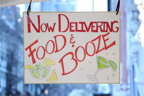 Now delivering food & booze  hand-drawn sign  Santa Fe  West 71st St  Manhattan