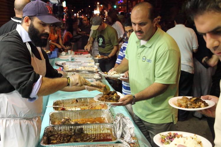Last call at the serving line  annual iftar feast  Balady Foods  Bay Ridge  Brooklyn