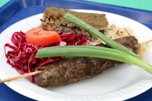 Kafta kebab platter with kibbe square at the Lebanese Food Festival  outside Our Lady of Lebanon Cathedral  Brooklyn Heights