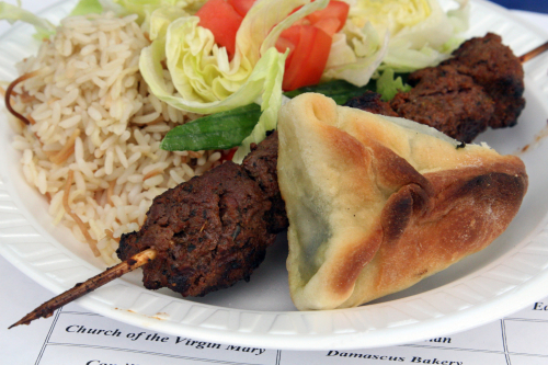 Shish kebab platter with spinach pie at the Lebanese Food Festival  outside Our Lady of Lebanon Cathedral  Brooklyn Heights