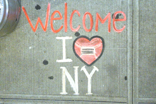 Welcome  I [heart] NY [enough to wear a mask]  hand-chalked artwork (after Milton Glaser  2020) outside Mel's Burger Bar  Broadway  Manhattan