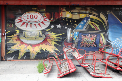Hand-painted pinball artwork (Tats Cru  2005) and upturned picnic tables  Old Fashioned Coney Island Food stall  Coney Island  Brooklyn