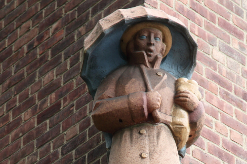 Sculpture of grocery shopper with umbrella  Parkchester  Bronx