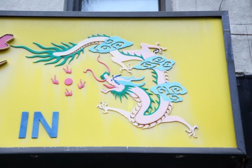 Dragon  detail of signage  the former Ming's Restaurant  Ninth Ave  Manhattan