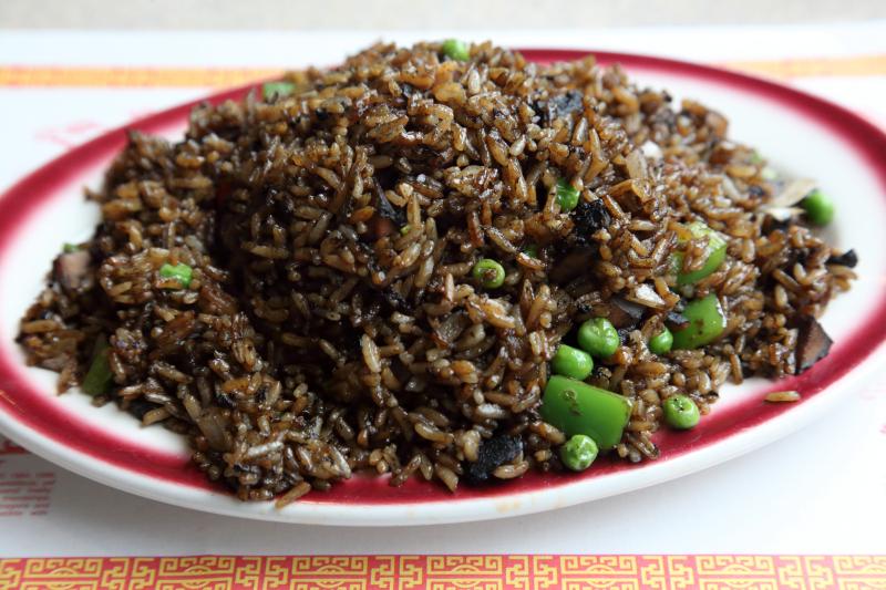 Arroz con calamares en su tinta  rice with squid in its own ink  La Caridad 78  Broadway  Manhattan