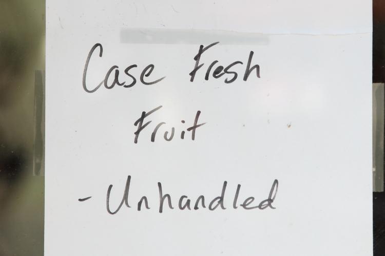Case fresh fruit  unhandled  handwritten sign  Mazzella's Market  Ninth Ave  Manhattan