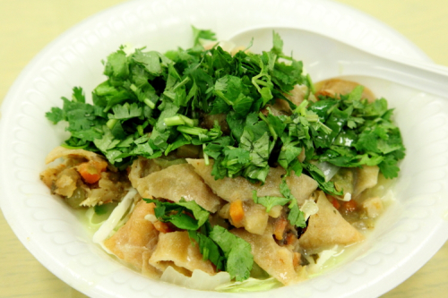 Samosa salad at a Burmese home-cooked food bazaar  Woodside  Queens