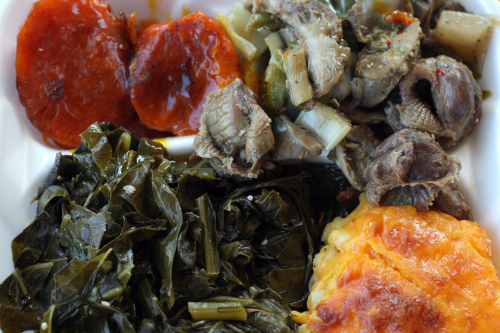 Candied yams  chicken gizzards  collard greens  and mac and cheese at Manna's  Adam Clayton Powell Junior Boulevard  New York