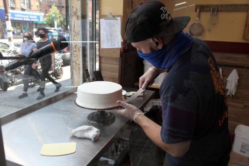 Royd Leyva at his windowside work area  La Gran Via Bakery  Jackson Heights  Queens (CB)