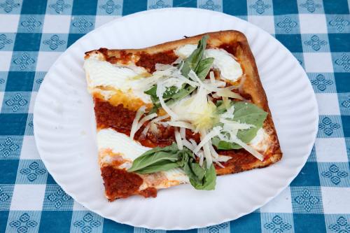 Roxanne slice (meat sauce  ricotta  fresh mozzarella  pecorino  Parmigiano Reggiano  and arugula)  Nonnas 1977  Astoria  Queens