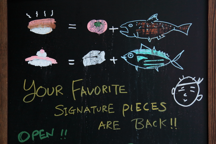 Your favorite signature pieces are back  hand-drawn signboard  Sushi of Gari  Columbus Ave  Manhattan