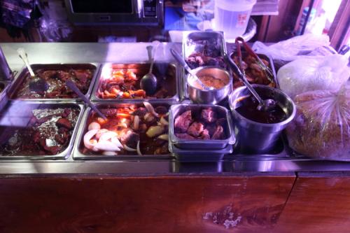 Display of prepared food (detail)  Galagala New York Restaurant  Mount Hope  Bronx