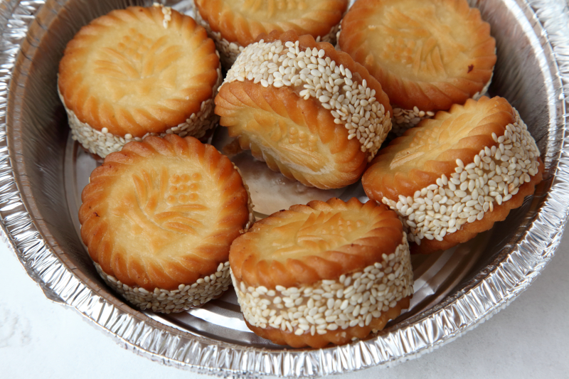 Sandwich cookies from a street vendor's display on the eve of Chinese New Year  Sunset Park  Brooklyn