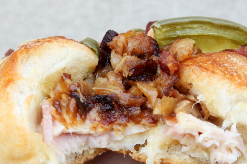 Top-loaded roll (biteaway view) with ham  cheese  bacon  and pepper  Jola Polish Deli  Jersey City