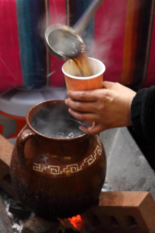 Ladling café de olla  Chalupas Poblanas El Tlecuile  Corona  Queens