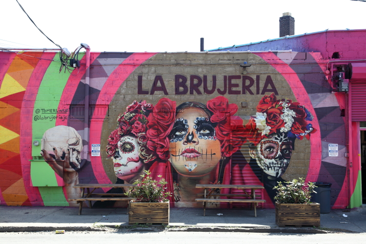 Hand-painted artwork (Tomer Linaje Medina  2020) and outdoor seating  La Brujeria  Jersey City